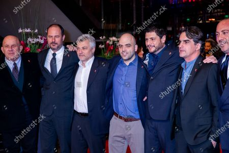(3rdL-R) Maurizio Braucci, Roberto Saviano, Claudio Giovannesi and guests arrives for the closing ceremony of the 69th Berlinale International Film Festival Berlin at Berlinale Palace on February 16, 2019 in Berlin, Germany.  (Photo by Manuel Romano/NurPhoto)