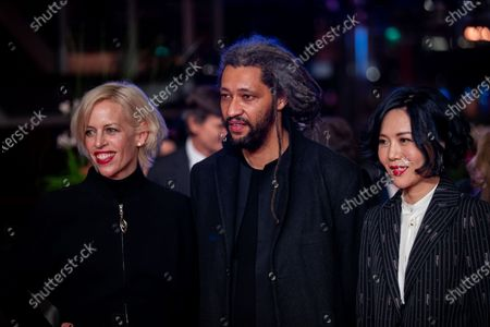 Stock Image of (L-R) Katja Eichinger, Alain Gomis and Vivian Qu arrives for the closing ceremony of the 69th Berlinale International Film Festival Berlin at Berlinale Palace on February 16, 2019 in Berlin, Germany.  (Photo by Manuel Romano/NurPhoto)
