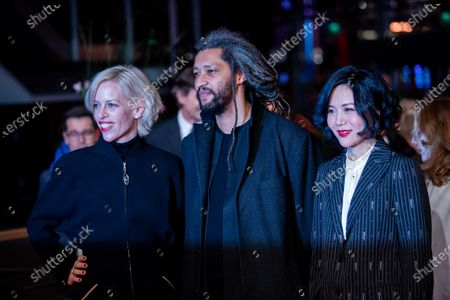 (L-R) Katja Eichinger, Alain Gomis and Vivian Qu arrives for the closing ceremony of the 69th Berlinale International Film Festival Berlin at Berlinale Palace on February 16, 2019 in Berlin, Germany.  (Photo by Manuel Romano/NurPhoto)