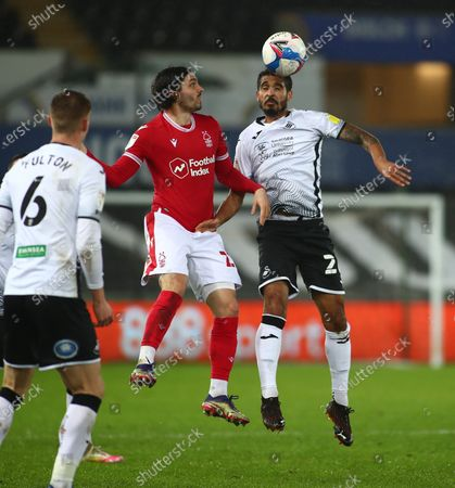 Kyle Naughton of Swansea City jumps to head the ball; Liberty Stadium, Swansea, Glamorgan, Wales; English Football League Championship Football, Swansea City versus Nottingham Forest.