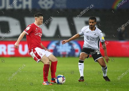 Joe Lolley of Nottingham Forest passes as he is pressured by Kyle Naughton of Swansea City; Liberty Stadium, Swansea, Glamorgan, Wales; English Football League Championship Football, Swansea City versus Nottingham Forest.