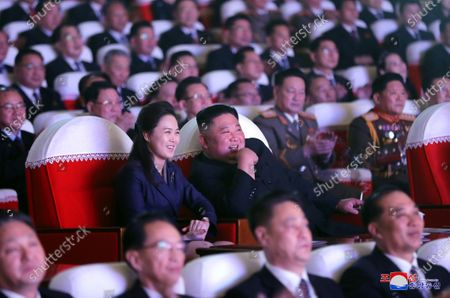 A photo released by the official North Korean Central News Agency (KCNA) shows Supreme Leader of North Korea Kim Jong-un (C-R) and his wife Ri Sol Ju (C-L) together with members of the Party central leadership organ watching a performance on the occasion of the Day of the Shining Star, the birth anniversary of Chairman Kim Jong Il, at Mansudae Art Theatre in Pyongyang, North Korea, 16 February 2021 (issued 17 February 2021).