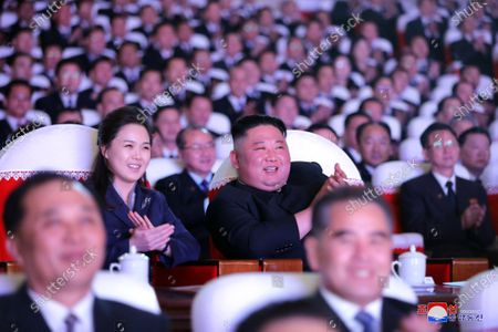 Stock Photo of A photo released by the official North Korean Central News Agency (KCNA) shows Supreme Leader of North Korea Kim Jong-un (C-R) and his wife Ri Sol Ju together with members of the Party central leadership organ watching a performance on the occasion of the Day of the Shining Star, the birth anniversary of Chairman Kim Jong Il, at Mansudae Art Theatre in Pyongyang, North Korea, 16 February 2021 (issued 17 February 2021).