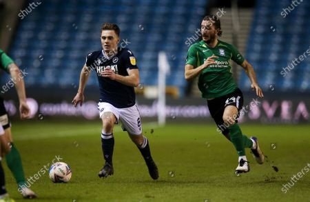 Ben Thompson of Millwall gets away from Ivan Sunjic of Birmingham City
