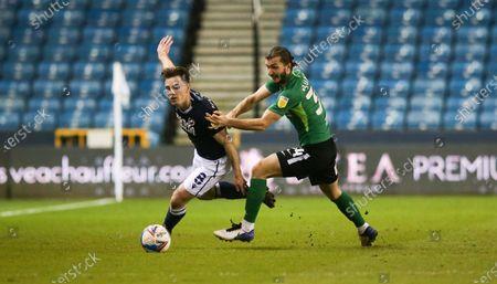 Ben Thompson of Millwall goes around Ivan Sunjic of Birmingham City