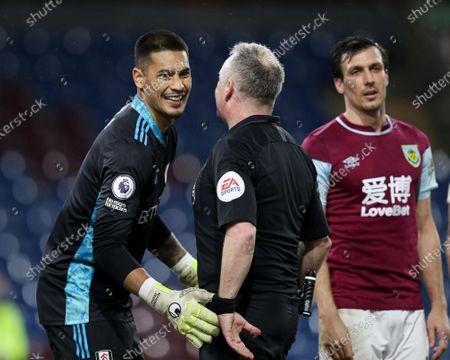 Fulham goalkeeper Alphonse Areola shares a joke with referee Jon Moss