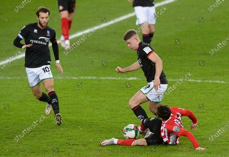 Josh Scowen of Sunderland tackles Tom Hopper of Lincoln City
