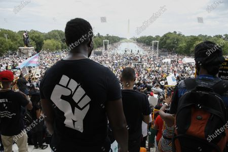 Thousands gather for the ''Get Your Knee Off Our Necks'' march on the anniversary of the 1963 Civil Rights March On Washington, at the Lincoln Memorial, in Washington DC USA, on August 28, 2020. National Action Network founder, Reverend Al Sharpton, in conjunction with the NAACP began planning the event following George Floyds' June funeral, the man who was killed by a Minneapolis Minnesota police officer who knelt on his neck for several minutes. This year on the 57th anniversary of Reverend Martin Luther King's ''I have A dream'' speech, participants endeavor to restore the commitment to the sentiment of the historic speech, underscoring demands for criminal justice and police reform, including racial equality.