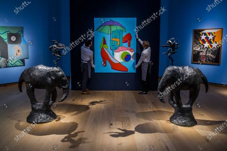 Barry Flanagan, Gendrd I / Gendrd II, bronze with a black patina, circa 1995, this cast is number 4 of 8. Estimate: £300,000-500,000 with Sir Michael Craig-Martin, with Red Shoes, Painted in 2000, Estimate: £60,000-80,000 - Behind Closed Doors: Preparations Take Place at Christie's for the livestreamed Modern British Art Auction on 1 March 2021.