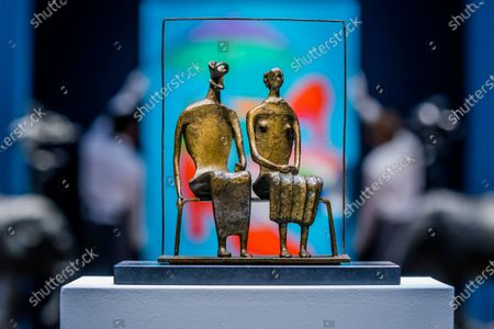 Henry Moore, Maquette for King and Queen, conceived and cast in 1952, estimate: £750,000-1,000,000 with Sir Michael Craig-Martin, With Red Shoes, Painted in 2000, Estimate: £60,000-80,000 - Behind Closed Doors: Preparations Take Place at Christie's for the livestreamed Modern British Art Auction on 1 March 2021.