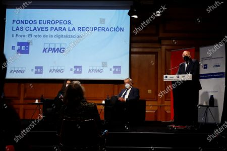 KPMG Spain's CEO Hilario Albarracin (R) delivers a speech at the headquarters of the Instituto Cervantes in Madrid, central Spain, 17 February 2021, during the second of the forums organized by EFE news agency and the consulting firm KPMG, with the theme 'The challenge of digitization', in which the opportunities that European funds represent for Spain after covid-19 are analyzed.