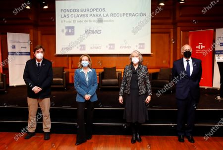 Stock Image of Spain's third deputy prime minister and Minister for Economy Affairs and Digital Transformation Nadia Calvino (2-L) pose for a family picture with Instituto Cervantes' director Luis Garcia Montero (L), Efe news agency president Gabriela Canas (2-R) and KPMG Spain's CEO Hilario Albarracin (R) at the headquarters of the Instituto Cervantes in Madrid, central Spain, 17 February 2021, during the second of the forums organized by EFE news agency and the consulting firm KPMG, with the theme 'The challenge of digitization', in which the opportunities that European funds represent for Spain after covid-19 are analyzed.