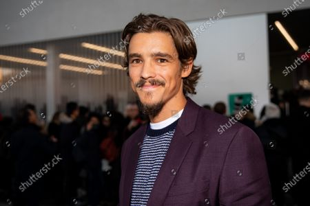 Stock Picture of Brenton Thwaites attends the Prada fashion show