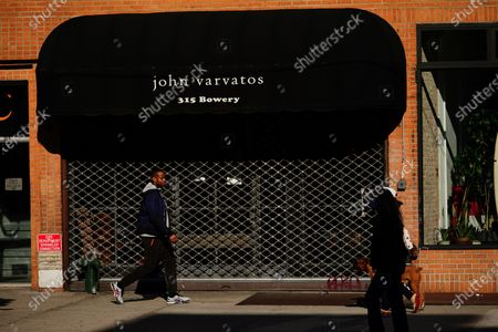 Stock Image of A view of  John Varvatos boutique during the coronavirus pandemic on May 13, 2020 in New York City. COVID-19 has spread to most countries around the world, claiming over 270,000 lives with over 3.9 million infections reported. (Bloomberg)- Rock-Star Outfitter John Varvatos's Firm Files for Bankruptcy.