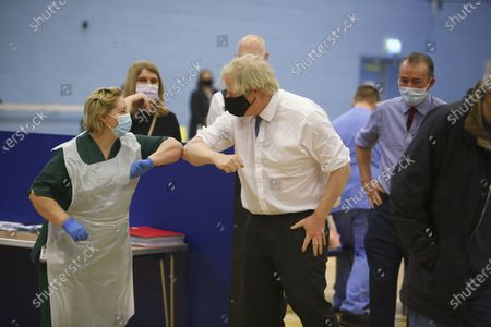 Stock Image of Britain's Prime Minister Boris Johnson greets nurse Louise Gray at a vaccination centre in Cwmbran, south Wales