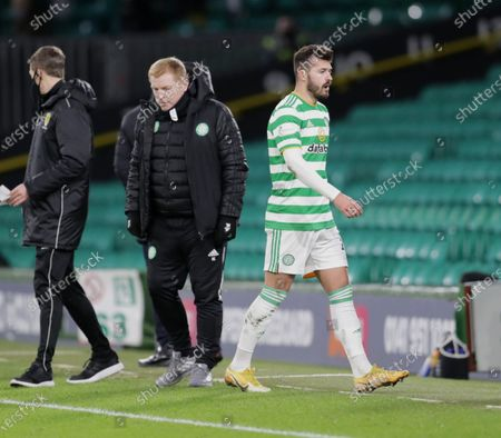 Albian Ajeti of Celtic walks past Celtic Manager Neil Lennon after being substituted