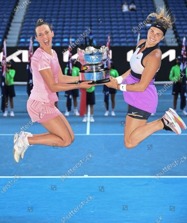 Elise Mertens and Aryna Sabalenka hold the trophy after winning the Women's Doubles Final