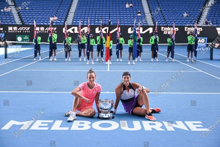 Stock Image of Elise Mertens and Aryna Sabalenka hold the trophy after winning the Women's Doubles Final