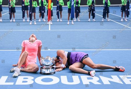 Stock Photo of Elise Mertens and Aryna Sabalenka hold the trophy after winning the Women's Doubles Final