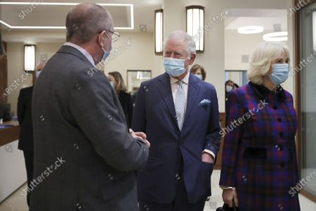 Britain's Prince Charles and Camilla, Duchess of Cornwall talk with staff during a visit to the Queen Elizabeth Hospital in Birmingham, England, to thank volunteers undertaking clinical trials for the COVID-19 vaccinations