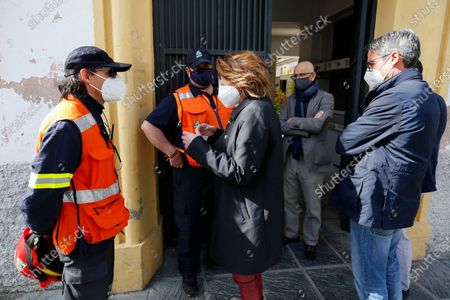 Susana Diaz, the General Secretary of PSOE in Andalusia, talks with two members of the Civil Protection group during her visit to the damaged buildings by earthquakes in Santa Fe, Granada, on February 17, 2021.