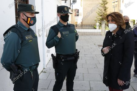 Susana Diaz, the General Secretary of PSOE in Andalusia, talks with two Civil Guards during her visit to the damaged buildings by earthquakes in Santa Fe, Granada, on February 17, 2021.