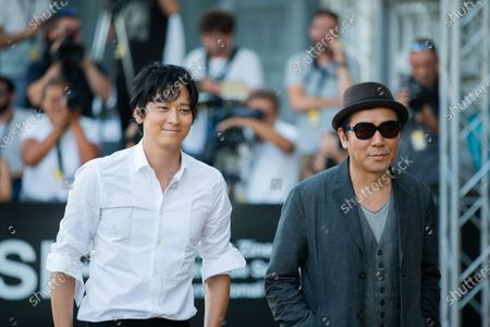 Jee-woon Kim (R) and Gang Dong-Won (L) is seen arriving at Maria Cristina Hotel during 66th San Sebastian Film Festival on September 26, 2018 in San Sebastian, Spain.