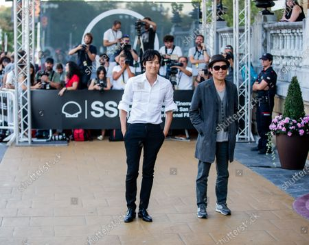 Stock Photo of Jee-woon Kim (R) and Gang Dong-Won (L) is seen arriving at Maria Cristina Hotel during 66th San Sebastian Film Festival on September 26, 2018 in San Sebastian, Spain.