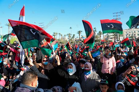 Under tight security, Libyans mark the 10th anniversary of their 2011 uprising that led to the overthrow and killing of longtime ruler Moammar Gadhafi in Martyrs Square, Tripoli, Libya. The country has become one of the most intractable conflicts left over from the Arab Spring uprisings. An interim government has been appointed in order to prepare the divided country for elections scheduled on Dec. 24