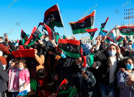Libyans mark the 10th anniversary of their 2011 uprising that led to the overthrow and killing of longtime ruler Moammar Gadhafi, in Martyrs Square, Tripoli, Libya. The country has become one of the most intractable conflicts left over from the Arab Spring uprisings. An interim government has been appointed in order to prepare the divided country for elections scheduled on Dec. 24