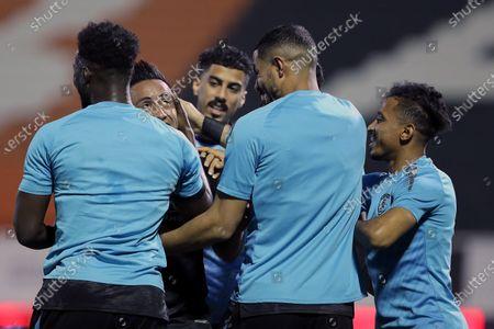 Al-Fateh's player Christian Cueva (2-L) celebrates with teammates after scoring a goal during the Saudi Professional League soccer match between Al-Shabab and Al-Fateh at Al-Shabab Club Stadium, in Riyadh, Saudi Arabia, 17 February 2021.