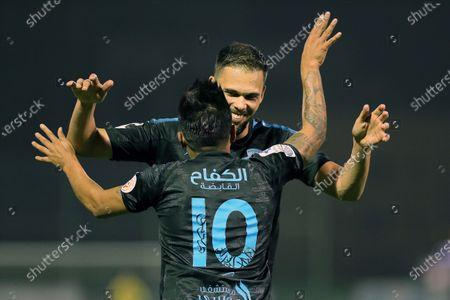 Al-Fateh's player Christian Cueva (front) celebrates with teammate Mitchell Te Vrede (back) after scoring a goal during the Saudi Professional League soccer match between Al-Shabab and Al-Fateh at Al-Shabab Club Stadium, in Riyadh, Saudi Arabia, 17 February 2021.