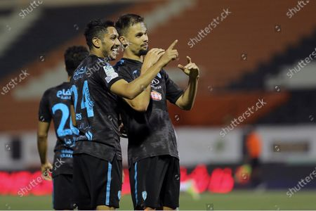 Al-Fateh's player Mitchell Te Vrede (R) celebrates with a teammate after scoring the winning goal (2-1) during the Saudi Professional League soccer match between Al-Shabab and Al-Fateh at Al-Shabab Club Stadium, in Riyadh, Saudi Arabia, 17 February 2021.