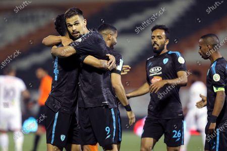 Al-Fateh's player Mitchell Te Vrede (2-L) celebrates with teammates after scoring the winning goal (2-1) during the Saudi Professional League soccer match between Al-Shabab and Al-Fateh at Al-Shabab Club Stadium, in Riyadh, Saudi Arabia, 17 February 2021.