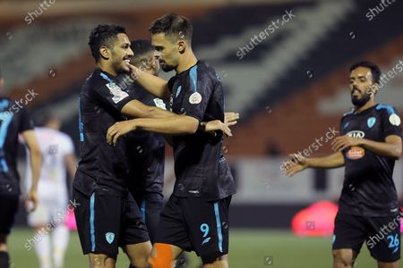 Al-Fateh's player Mitchell Te Vrede (2-R) celebrates with a teammate after scoring the winning goal (2-1) during the Saudi Professional League soccer match between Al-Shabab and Al-Fateh at Al-Shabab Club Stadium, in Riyadh, Saudi Arabia, 17 February 2021.