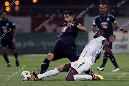 Al-Shabab's player Alfred N'Diaye (R) in action against Al-Fateh's Hassan Al-Habib (L) during the Saudi Professional League soccer match between Al-Shabab and Al-Fateh at Al-Shabab Club Stadium, in Riyadh, Saudi Arabia, 17 February 2021.