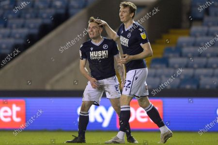 Ben Thompson of Millwall Celebrates scoring their sides second goal with Jon Dadi Bodvarsson during the Sky Bet Championship, Championship match between Millwall and Birmingham City at The Den in London - 17th February 2021
