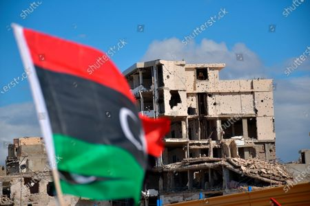 Damaged building is seen as Libyans mark the 10th anniversary of their 2011 uprising that led to the overthrow and killing of longtime ruler Moammar Gadhafi, in Benghazi, Libya. The country has become one of the most intractable conflicts left over from the Arab Spring uprisings. An interim government has been appointed in order to prepare the divided country for elections scheduled on Dec. 24