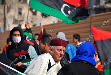 Libyans mark the 10th anniversary of their 2011 uprising that led to the overthrow and killing of longtime ruler Moammar Gadhafi, in Benghazi, Libya. The country has become one of the most intractable conflicts left over from the Arab Spring uprisings. An interim government has been appointed in order to prepare the divided country for elections scheduled on Dec. 24