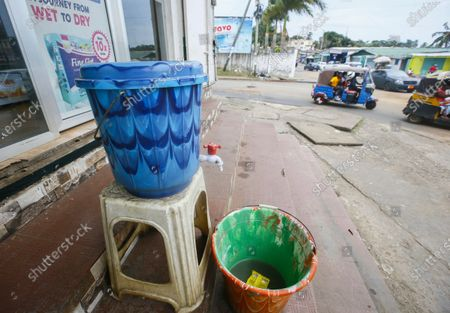 A Chlorinated water bucket for washing hands placed by a road side as a government measure to prevent the outbreak of Ebola, Monrovia, Liberia 17 February 2021.  According to a statement from the office of Liberian President George Weah on 14 February 2021 the president has placed Liberia's health authorities on an increased alert level following the death of four people from Ebola in neighbouring Guinea marking five years since the last cases were recorded.