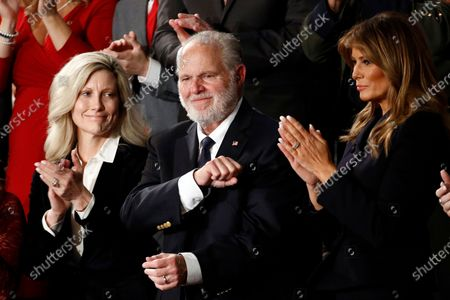 Rush Limbaugh reacts as first Lady Melania Trump, and his wife Kathryn, applaud, as President Donald Trump delivers his State of the Union address to a joint session of Congress on Capitol Hill in Washington. Limbaugh, the talk radio host who became the voice of American conservatism, has died