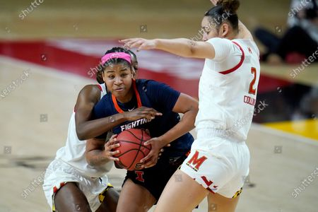 Stock Photo of Illinois guard Jeanae Terry, center, is defended by Maryland guard Diamond Miller, left, and forward Mimi Collins during the first half of an NCAA college basketball game, in College Park, Md