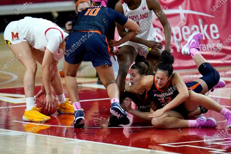 Illinois' Jeanae Terry (10), Geovana Lopes, second from bottom right, and Aaliyah Nye, bottom right, compete for a loose ball against Maryland's Diamond Miller (1) and Mimi Collins, left, during the second half of an NCAA college basketball game, in College Park, Md