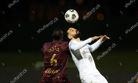 Stock Picture of Al-Ahli's player Driss Fettouhi (R) in action against Al-Ain's Badou Ndiaye (L) during the Saudi Professional League soccer match between Al-Ahli and Al-Ain at King Abdullah Sport City Stadium, 30 kilometers north of Jeddah, Saudi Arabia, 17 February 2021.