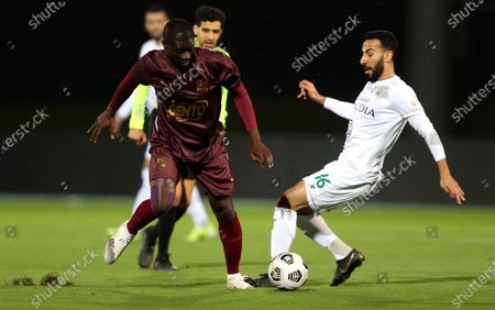 Al-Ahli's player Nouh Al-Mousa (R) in action against Al-Ain's Badou Ndiaye (L) during the Saudi Professional League soccer match between Al-Ahli and Al-Ain at King Abdullah Sport City Stadium, 30 kilometers north of Jeddah, Saudi Arabia, 17 February 2021.
