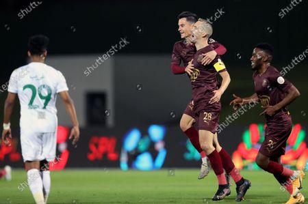 Al-Ain's player Filip Bradaric (2-R) celebrates after scoring a goal during the Saudi Professional League soccer match between Al-Ahli and Al-Ain at King Abdullah Sport City Stadium, 30 kilometers north of Jeddah, Saudi Arabia, 17 February 2021.