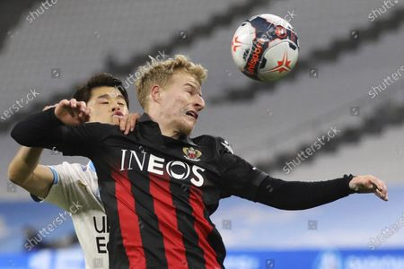 Nice's Alexis Trouillet, right, is challenged by Marseille's Hiroki Sakai during the French League One soccer match between Olympique de Marseille and Nice at the Velodrome stadium in Marseille, southern France