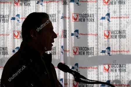 """Gov. Andrew Cuomo speaks to reporters during a news conference at a COVID-19 pop-up vaccination site in the William Reid Apartments in the Brooklyn borough of New York. Democratic Assembly member Ron Kim says Gov. Cuomo vowed to """"destroy"""" him, during a private phone call last week for criticizing his handling of COVID-19 outbreaks at nursing homes. Cuomo, who has long had a reputation for playing rough in politics, denied the allegation Wednesday, Feb. 17"""