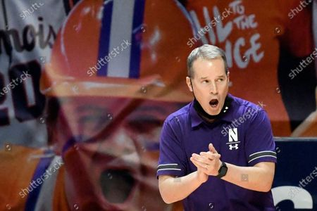 Northwestern coach Chris Collins cheers his team from the sideline during the first half of an NCAA college basketball game against Illinois, in Champaign, Ill