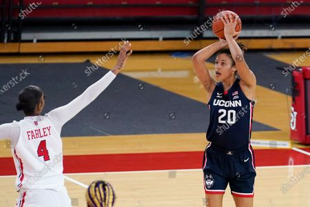Connecticut forward Olivia Nelson-Ododa (20) shoots over St. John's forward Raven Farley (4) during the second quarter of an NCAA college basketball game, in New York